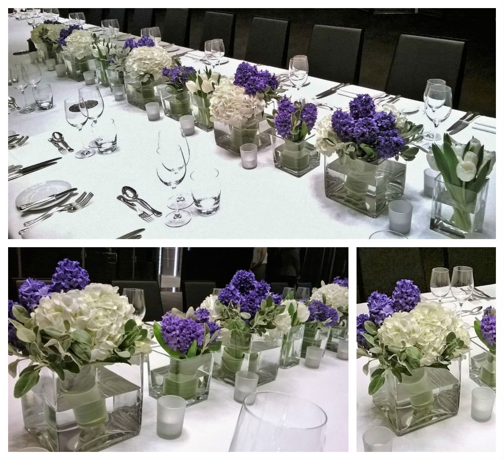 White Hydrangeas and Tulips mixed with purple Hyacinthus. Centerpiece with a cluster of clear glass cubes.